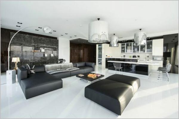 Черная мебель на белом полу