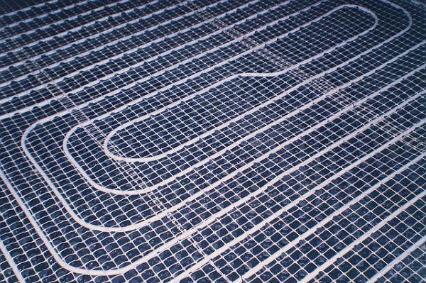 Укладка теплого пола поверх пластиковой армирующей сетки