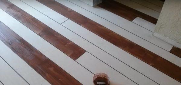 Любопытный вариант - покраска бетонного пола под ламинат