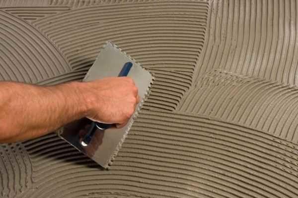 Распределение плиточного клея