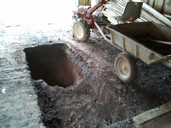 Процесс выемки грунта