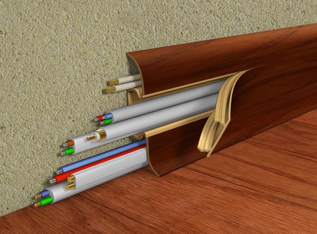 ПВХ-плинтус способен порой скрыть целый «хвост» различных силовых и сигнальных кабелей.